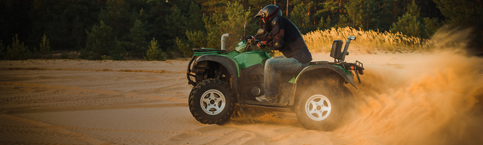 Man riding four wheeler in the sand